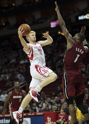 HOUSTON - DECEMBER 29: Chase Budinger #10 of the Houston Rockets drives the basket over Chris Bosh #1 of the Miami Heat in the second half at Toyota Center on December 29, 2010 in Houston, Texas. Miami won 125-119. NOTE TO USER: User expressly acknowledge