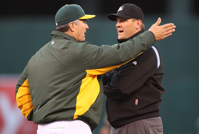 OAKLAND, CA - MAY 27:  Manager Bob Geren of the Oakland Athletics argues with umpire Chad Fairchild on a foul ball call in the second inning against the Baltimore Orioles during a Major League Baseball game at the Oakland-Alameda County Coliseum on May 27