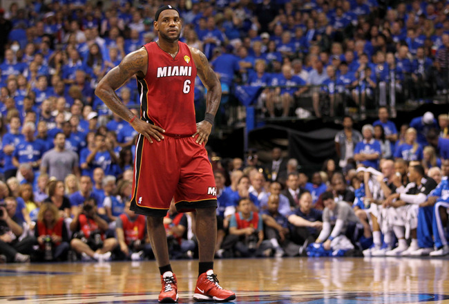 DALLAS, TX - JUNE 07:  LeBron James #6 of the Miami Heat looks on against the Dallas Mavericks in Game Four of the 2011 NBA Finals at American Airlines Center on June 7, 2011 in Dallas, Texas. NOTE TO USER: User expressly acknowledges and agrees that, by