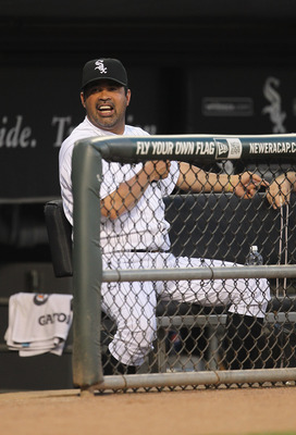 CHICAGO, IL - JUNE 08: Manager Ozzie Guillen #13 of the Chicago White Sox talks to a coach during a game against the Seattle Mariners at U.S. Cellular Field on June 8, 2011 in Chicago, Illinois. (Photo by Jonathan Daniel/Getty Images)