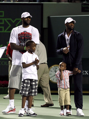 KEY BISCAYNE, FL - MARCH 26:  LeBron James (L) and Dwyane Wade of the NBA Miami Heat stand the court with Wade's sons Zaire (L) and Zion (holding Wade's hand) during the Sony Ericsson Open at Crandon Park Tennis Center on March 26, 2011 in Key Biscayne, F