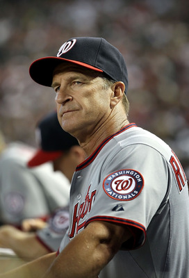 PHOENIX, AZ - JUNE 05:  Manager Jim Riggleman of the Washington Nationals watches from the dugout during the Major League Baseball game against the Arizona Diamondbacks at Chase Field on June 5, 2011 in Phoenix, Arizona. The Nationals defeated the Diamond