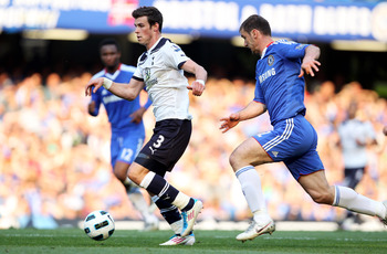 LONDON, ENGLAND - APRIL 30:  Gareth Bale of Spurs is pursued by Branislav Ivanovic of Chelsea during the Barclays Premier League match between Chelsea and Tottenham Hotspur at Stamford Bridge on April 30, 2011 in London, England.  (Photo by Clive Rose/Get