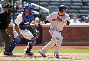 NEW YORK, NY - MAY 05:  Jonathan Sanchez #57 of the San Francisco Giants follows through on his fifth inning RBI single against the New York Mets on May 5, 2011 at Citi Field in the Flushing neighborhood of the Queens borough of New York City.  (Photo by