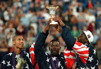 14 AUG 1994: REGGIE MILLER, JOE DUMARS AND LARRY JOHNSON CELEBRATE WITH THE TROPHY AS THE USA  DREAM TEAM II DEFEATS RUSSIA 137-91 IN THE WORLD CHAMPIONSHIP FINAL AT THE SKYDOME STADIUM IN TORONTO, ONTARIO, CANADA. Mandatory Credit: Doug Pensinger/ALLSPO