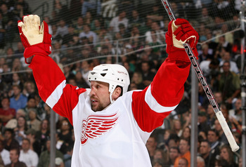 DALLAS - MAY 19:  Dallas Drake #17 of the Detroit Red Wings celebrates after scoring a first period goal against the Dallas Stars during game six of the Western Conference Finals of the 2008 NHL Stanley Cup Playoffs at American Airlines Center on May 19,
