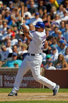 CHICAGO - JUNE 20: Carlos Zambrano #38 of the Chicago Cubs hits a single in the 7th inning against the Los Angeles Angels of Anaheim at Wrigley Field on June 20, 2010 in Chicago, Illinois. The Cubs defeated the Angels 12-1. (Photo by Jonathan Daniel/Getty