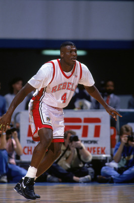 MARCH - 1991:  Larry Johnson #4 of the University of Las Vegas Nevada Rebels plays defense during an NCAA game against Cal State Long Beach in March of 1991.  (Photo by Ken Levine/Getty Images)