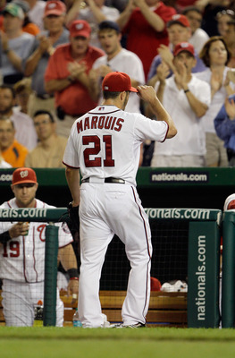 WASHINGTON, DC - MAY 31: Starting pitcher Jason Marquis #21 of the Washington Nationals tips his hat to the crowd after being removed during the seventh inning against the Philadelphia Phillies at Nationals Park on May 31, 2011 in Washington, DC. The Nati