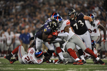 BALTIMORE - AUGUST 28:  Le'Ron McClain #33 of the Baltimore Ravens runs the ball against the New York Giants at M&T Bank Stadium on August 28, 2010 in Baltimore, Maryland. The Ravens lead the Giants 17-3. (Photo by Larry French/Getty Images)