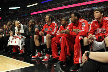 CHICAGO, IL - MAY 26:  Chicago Bulls players look on from the bench including Carlos Boozer #5, Joakim Noah #13 (C) and Kyle Korver #26 late in the fourth quarter against the Miami Heat in Game Five of the Eastern Conference Finals during the 2011 NBA Pla
