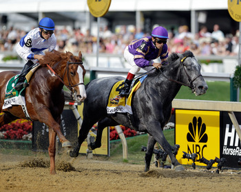 BALTIMORE, MD - MAY 21:  Jockey Jesus Castanon aboard Shackleford #5 (L) and Flashpoint with jockey Cornelio Velasquez #4 (R) in the irons head into the first turn during the 136th running of the Preakness Stakes at Pimlico Race Course on May 21, 2011 in