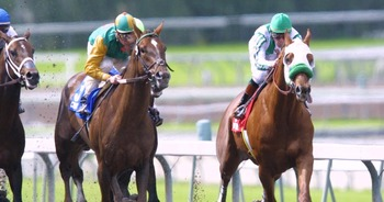 7 Apr 2001:  Point Given ridden by Gary Stevens (far right) takes an early lead over C.T. Crafty ridden by Eddie Delahoussaye during the Santa Anita Derby at Santa Anita Park in Arcadia, California. DIGITAL IMAGE. Mandatory Credit: Jeff Gross/ALLSPORT