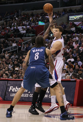 LOS ANGELES, CA - DECEMBER 20:  Blake Griffin #32 of the Los Angeles Clippers is defended by Michael Beasley #8 of the Minnesota Timberwolves during the second half at Staples Center on December 20, 2010 in Los Angeles, California. The Clippers defeated t