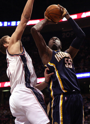 EAST RUTHERFORD, NJ - JANUARY 15:  Roy Hibbert #55 of the Indiana Pacers shoots against Brook Lopez #11 of the New Jersey Nets at the Izod Center on January 15, 2010 in East Rutherford, New Jersey. NOTE TO USER: User expressly acknowledges and agrees that