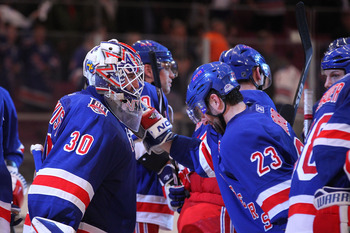NEW YORK, NY - APRIL 17:  (L-R) Goalie Henrik Lundqvist #30 and Chris Drury #23 of the New York Rangers celebrate after the Rangers won 3-2 against the Washington Capitals in Game Three of the Eastern Conference Quarterfinals during the 2011 NHL Stanley C