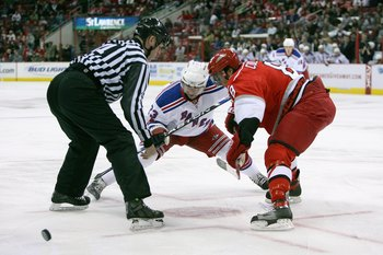 RALEIGH, NC - FEBRUARY 28:  Chris Drury #23 of the New York Rangers takes the faceoff against Matt Cullen #8 of the Carolina Hurricanes during their NHL game at RBC Center on February 28, 2008 in Raleigh, North Carolina. The Rangers defeated the Hurricane