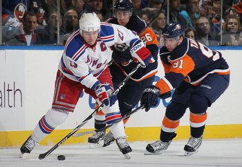 UNIONDALE, NY - MARCH 30:  Chris Drury #23 of the New York Rangers skates against John Tavares #91 of the New York Islanders at the Nassau Coliseum on March 30, 2010 in Uniondale, New York.  (Photo by Bruce Bennett/Getty Images)