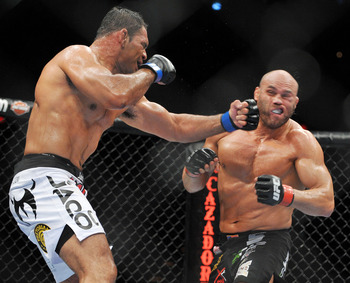 PORTLAND, OR - AUGUST 29:  UFC fighter Antonio Nogueira (L) battles UFC fighter Randy Couture (R) during their Heavyweight bout at UFC 102:  Couture vs. Nogueira at the Rose Garden Arena on August 29, 2009 in Portland, Oregon.  (Photo by Jon Kopaloff/Gett