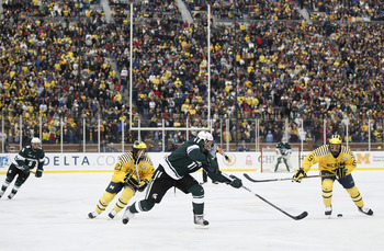 Michigan defeats Michigan State 5-0 before more than 104,000, setting a Guinness  world attendance record for a hockey game.