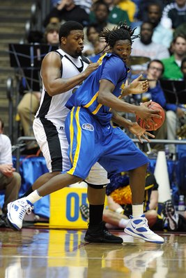 DAYTON, OH - MARCH 17:  Kenneth Faried #35 of the Morehead State Eagles attempts to drive against Roland Fitch #34 of the Alabama State Hornets during the opening round of the Men's NCAA Tournament on March 17, 2009 at the University of Dayton Arena in Da
