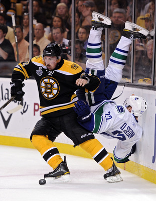 BOSTON, MA - JUNE 08:  Brad Marchand #63 of the Boston Bruins dodges Daniel Sedin #22 of the Vancouver Canucks during Game Four of the 2011 NHL Stanley Cup Final at TD Garden on June 8, 2011 in Boston, Massachusetts.  (Photo by Harry How/Getty Images)