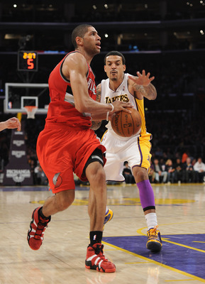 LOS ANGELES, CA - MARCH 20:  Nicolas Batum #88 of the Portland Trail Blazers is chased by Matt Barnes #9 of the Los Angeles Lakers at the Staples Center on March 20, 2011 in Los Angeles, California.  NOTE TO USER: User expressly acknowledges and agrees th