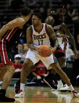 MILWAUKEE, WI - DECEMBER 06: Chris Douglas-Roberts #17 of the Milwaukee Bucks looks to pass between Juwan Howard #5 and LeBron James #6 of the Miami Heat at the Bradley Center on December 6, 2010 in Milwaukee, Wisconsin. The Heat defeated the Bucks 88-78.
