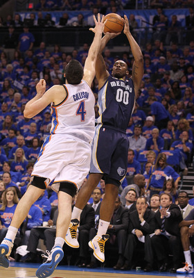 OKLAHOMA CITY, OK - MAY 15: Forward Darrell Arthur #00 of the Memphis Grizzlies takes a shot against Nick Collison #4 of the Oklahoma City Thunder in Game Seven of the Western Conference Semifinals in the 2011 NBA Playoffs on May 15, 2011 at Oklahoma City