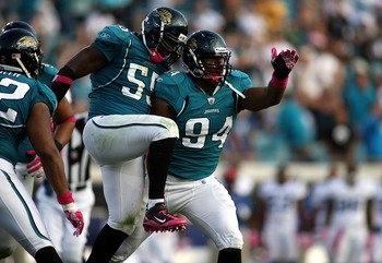 JACKSONVILLE, FL - OCTOBER 03:  Lineman Jeremy Mincey #94 of the Jacksonville Jaguars celebrates with Kirk Morreson after sacking Quarterback Peyton Manning #18 of the Indianapolis Colts at EverBank Field on October 3, 2010 in Jacksonville, Florida.  (Pho