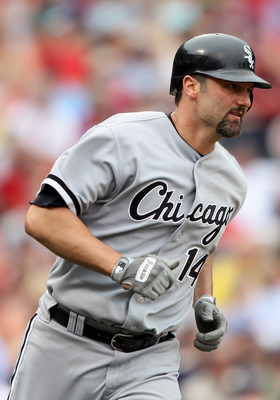 BOSTON, MA - JUNE 01:  Paul Konerko #14 of the Chicago White Sox rounds first after he hit a two run home run in the ninth inning against the Boston Red Sox on June 1, 2011 at Fenway Park in Boston, Massachusetts.  (Photo by Elsa/Getty Images)