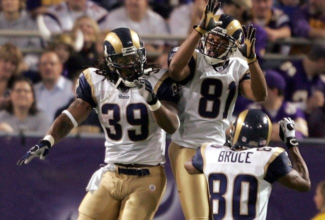 MINNEAPOLIS - DECEMBER 31:  Steven Jackson #39 of the St. Louis Rams celebrates his 59 yard touchdown run with teammates Isaac Bruce #80 and Torry Holt #81 against the Minnesota Vikings on December 31, 2006 at the Hubert H. Humphrey Metrodome in Minneapol