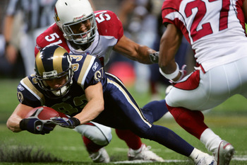 ST. LOUIS - NOVEMBER 20:  Wide receiver Kevin Curtis #83 of the St. Louis Rams dives during the game against of the Arizona Cardinals on November 20, 2005 at the Edward Jones Dome in St. Louis, Missouri. The Arizona Cardinals defeated the St. Louis Rams 3