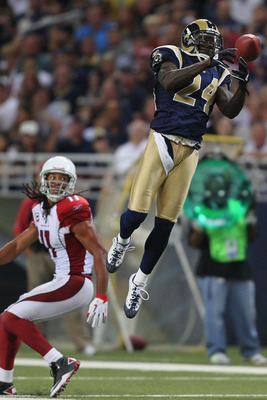 ST. LOUIS - SEPTEMBER 12: Ron Bartell #24 of the St. Louis Rams attempts to pick off a pass intended for Larry Fitzgerald #11 of the Arizona Cardinalsduring the NFL season opener at the Edward Jones Dome on September 12, 2010 in St. Louis, Missouri.  The