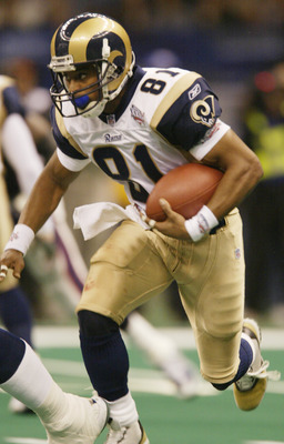 3 Feb 2002:  Wide receiver Az-Zahir Hakim #81 of the St. Louis Rams carries the ball after a catch during the second quarter of Super Bowl XXXVI against the New England Patriots at the Superdome in New Orleans, Louisiana. DIGITAL IMAGE.  Mandatory Credit: