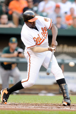 BALTIMORE, MD - JUNE 06:  Vladimir Guerrero #27 of the Baltimore Orioles hits a single in the first inning against the Oakland Athletics at Oriole Park at Camden Yards on June 6, 2011 in Baltimore, Maryland.  (Photo by Greg Fiume/Getty Images)