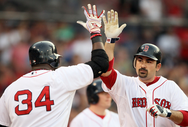 BOSTON, MA - MAY 30:  Adrian Gonzalez #28 of the Boston Red Sox is congratulated by teammate David Ortiz #34 after Gonzalez hits a a solo home run in the first inning against the Chicago White Sox on May 30, 2011 at Fenway Park in Boston, Massachusetts.