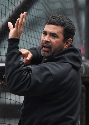 CHICAGO, IL - JUNE 09:  Manager Ozzie Guillen #13 of the Chicago White Sox talks with a player during batting practice before a game against the Oakland Athletics at U.S. Cellular Field on June 9, 2011 in Chicago, Illinois.  (Photo by Jonathan Daniel/Gett