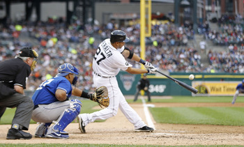 DETROIT - MAY 14:  Jhonny Peralta #27 of the Detroit Tigers hits his 1,000 career base hit during the sixth inning of the game against the Kansas City Royals at Comerica Park on May 14, 2011 in Detroit, Michigan.  (Photo by Leon Halip/Getty Images)