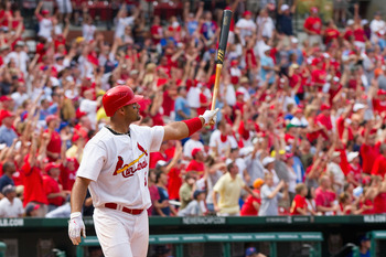 ST. LOUIS, MO - JUNE 5: Albert Pujols #5 of the St. Louis Cardinals watches his walk-off home run against the Chicago Cubs leave the field at Busch Stadium on June 5, 2011 in St. Louis, Missouri.  The Cardinals beat the Cubs 3-2 in 10 innings.  (Photo by