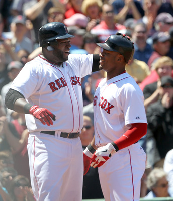 BOSTON, MA - JUNE 5: Carl Crawford #13 of the Boston Red Sox celebrates his three-run home run with teammate David Ortiz #34 against the Oakland Athletics at Fenway Park on June 5, 2011 in Boston, Massachusetts. (Photo by Jim Rogash/Getty Images)