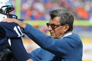 TAMPA, FL - JANUARY 1:  Coach Joe Paterno of the Penn State Nittany Lions directs play of quarterback Matt McGloin #11 against the Florida Gators January 1, 2010 in the 25th Outback Bowl at Raymond James Stadium in Tampa, Florida.  (Photo by Al Messerschm