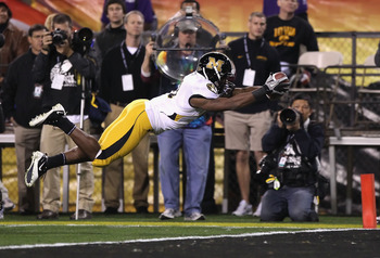 TEMPE, AZ - DECEMBER 28:  Runningback Henry Josey #41 of the Missouri Tigers dives into the endzone to score on a 10 yard rushing touchdown against the Iowa Hawkeyes during the second quarter of the Insight Bowl at Sun Devil Stadium on December 28, 2010 i