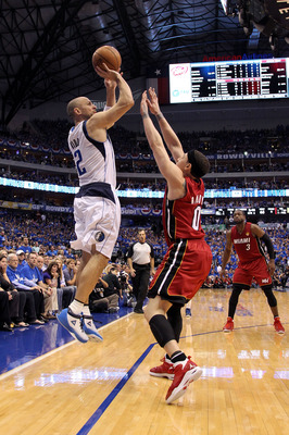 DALLAS, TX - JUNE 07:  Jason Kidd #2 of the Dallas Mavericks attempts a shot against the Mike Bibby #0 of the Miami Heat in Game Four of the 2011 NBA Finals at American Airlines Center on June 7, 2011 in Dallas, Texas. The Mavericks won 86-83. NOTE TO USE