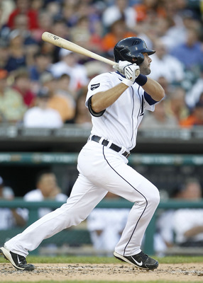 DETROIT - JUNE 01: Alex Avila #13 of the Detroit Tigers singles to left field scoring teammate Victor Martinez #41 during the second inning of the game against the Minnesota Twins at Comerica Park on June 1, 2011 in Detroit, Michigan.  (Photo by Leon Hali