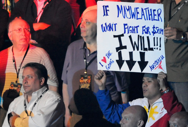 LAS VEGAS, NV - MAY 07:  A fan holds up a sign referring to boxer Floyd Mayweather Jr. before the WBO welterweight title fight between Manny Pacquiao and Shane Mosley at the MGM Grand Garden Arena May 7, 2011 in Las Vegas, Nevada.  (Photo by Ethan Miller/