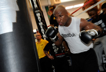 LAS VEGAS - APRIL 14:  Boxer Floyd Mayweather Jr. hits a heavy bag during a workout April 14, 2010 in Las Vegas, Nevada. Mayweather is scheduled to face Shane Mosley in a 12-round welterweight bout on May 1, 2010 in Las Vegas.  (Photo by Ethan Miller/Gett