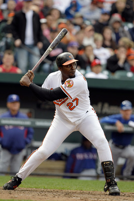 BALTIMORE, MD - APRIL 10:  Vladimir Guerrero #27 of the Baltimore Orioles at the plate against the Texas Rangers at Oriole Park at Camden Yards on April 10, 2011 in Baltimore, Maryland.  (Photo by Rob Carr/Getty Images)