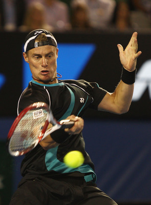 MELBOURNE, AUSTRALIA - JANUARY 18:  Lleyton Hewitt of Australia plays a forehand his first round match against David Nalbandian of Argentina during day two of the 2011 Australian Open at Melbourne Park on January 18, 2011 in Melbourne, Australia.  (Photo