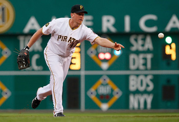 PITTSBURGH - JUNE 09:  Lyle Overbay #37 of the Pittsburgh Pirates flips the ball to first base against the Arizona Diamondbacks during the game on June 9, 2011 at PNC Park in Pittsburgh, Pennsylvania.  (Photo by Jared Wickerham/Getty Images)